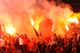 Galatasaray's fans light flares at the game with Sporting Braga during their Champions League Group H soccer match, at the Municipal stadium, in Braga, Portugal, Wednesday, Dec. 5, 2012. (AP Photo/Paulo Duarte)