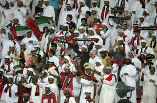 Supporters of the Emirati team cheer their players during their group five World Cup qualifying football match against Kuwait in Kuwait City on June 14, 2008. The UAE beat Kuwait 3-2. AFP PHOTO/YASSER AL-ZAYYAT (Photo credit should read YASSER AL-ZAYYAT/AFP/Getty Images)