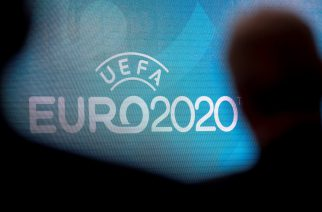 (FILES) In this file photo taken on September 21, 2016 a screen displays the logo for the 2020 UEFA European Championship football tournament in London during a launch event. - UEFA has proposed postponing the European Championship, due to take place across the continent in June and July this year, until 2021 at crisis meetings on March 17, 2020, a source close to European football's governing body told AFP. The move comes with football across the continent having ground to a halt due to the ongoing coronavirus pandemic which has led to lockdowns in several countries and border closures. (Photo by JUSTIN TALLIS / AFP)